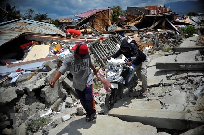 IMF quyên góp ủng hộ các nạn nhân động đất, sóng thần tại Indonesia Ảnh 1