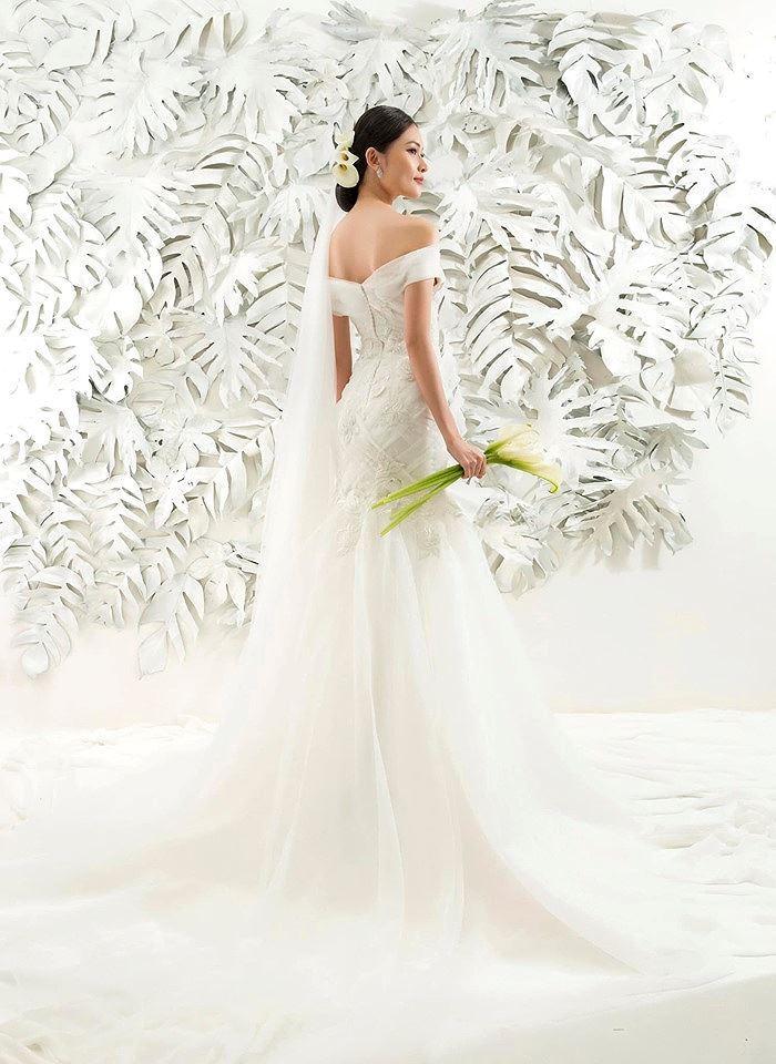 Sau khi công khai bạn trai, Á hậu Thùy Dung gợi cảm với váy cưới xuyên thấu Ảnh 8