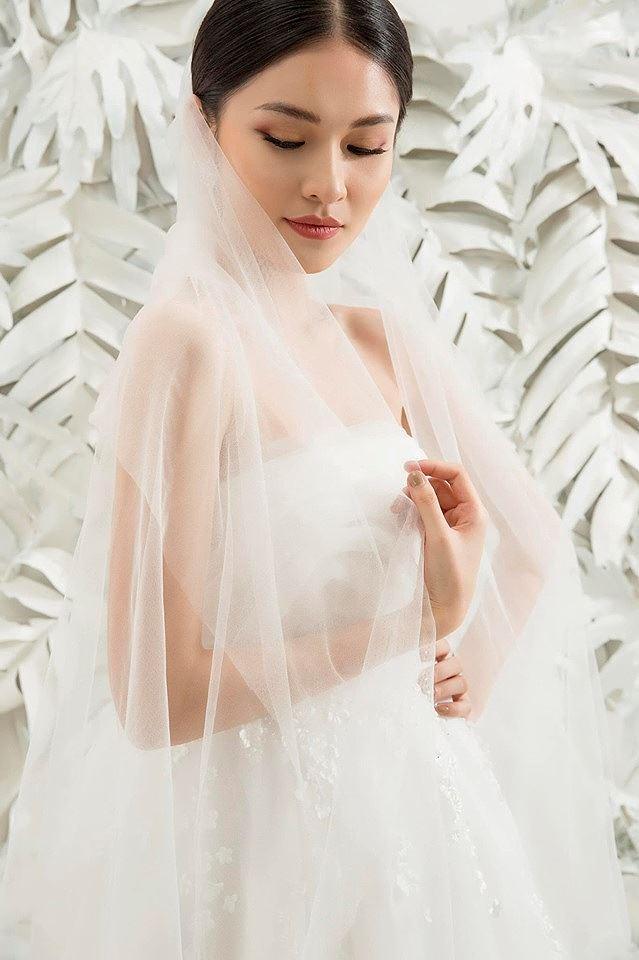 Sau khi công khai bạn trai, Á hậu Thùy Dung gợi cảm với váy cưới xuyên thấu Ảnh 12