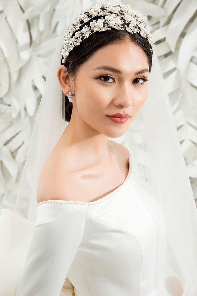 Sau khi công khai bạn trai, Á hậu Thùy Dung gợi cảm với váy cưới xuyên thấu Ảnh 11