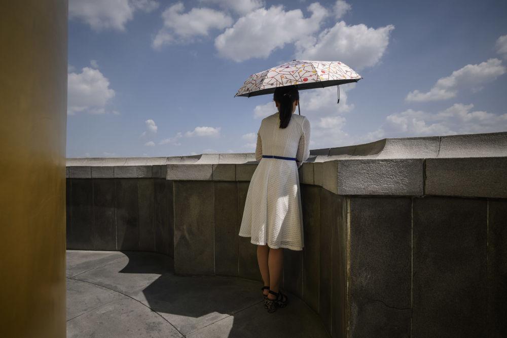 Người Triều Tiên giải nhiệt trong nắng hè Ảnh 10