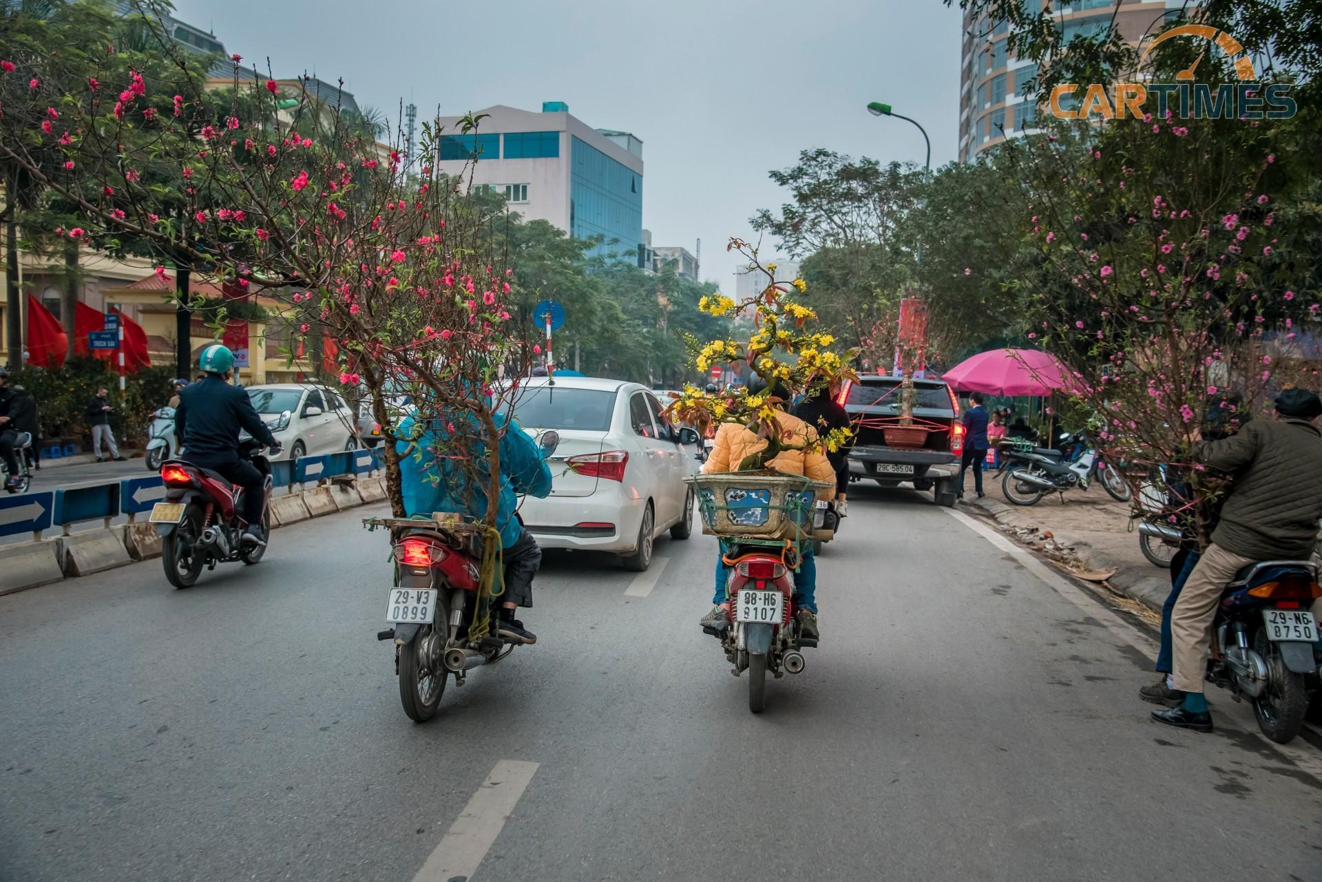 Chùm ảnh: Xuân về len lỏi trên những chiếc xe nhiều sắc màu Ảnh 21