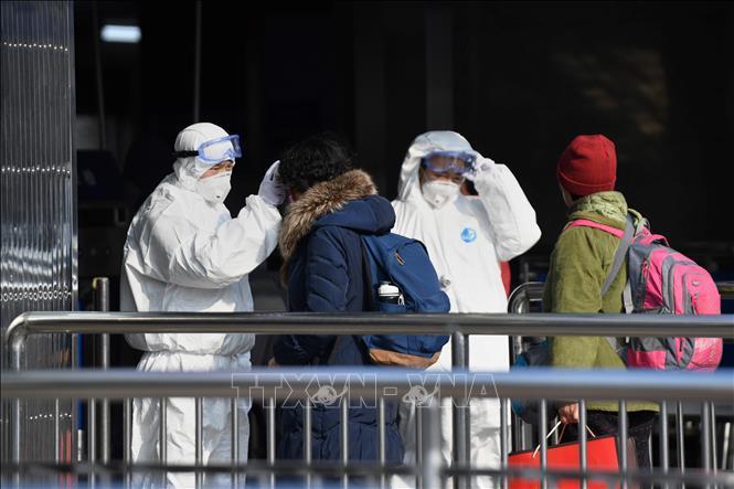 Trung Quốc cảnh báo virus corona lây lan ngày càng mạnh Ảnh 1