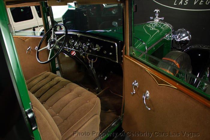 Xe Cadillac mui trần chống đạn của ông trùm Al Capone được đấu giá 1 triệu USD Ảnh 10