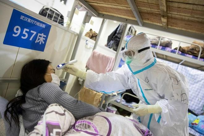 Ông Tập yêu cầu tăng cường bảo vệ bác sĩ, y tá chống virus corona Ảnh 1