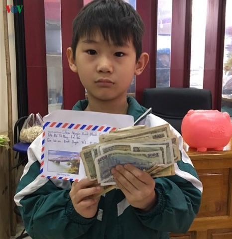 Cậu bé 8 tuổi ở Yên Bái đập lợn tiết kiệm ủng hộ chống dịch Covid-19 Ảnh 1
