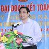Đồng chí Phạm Minh Chính, Ủy viên Bộ Chính trị, Bí thư Trung ương Đảng, Trưởng Ban Tổ chức Trung ương chung vui Ngày hội Đại đoàn kết toàn dân tộc tại làng Chiềng Tây
