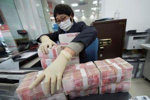 Trung Quốc tiêu hủy, khử trùng tiền mặt tại các vùng dịch