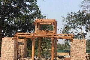 Hội đồng nào quyết định trùng tu và xây cổng tam quan chùa Bổ Đà?