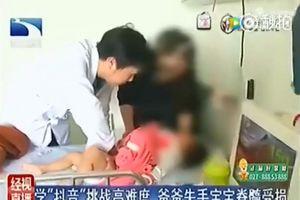 Cố kéo tay con lên cao vui đùa, người bố khóc ròng khi con bị chấn thương cột sống
