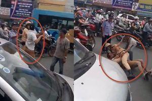 Hà Nội: Cảnh sát giao thông quật ngã tài xế taxi giữa phố