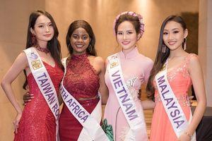 Diệu Linh nổi bật với tà áo dài truyền thống tại cuộc thi Nữ hoàng Du lịch Quốc tế 2018