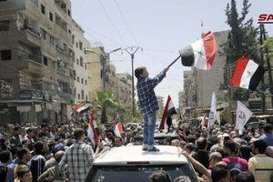 Chùm ảnh: Quân đội Syria giương cờ tại 3 thị trấn chiến lược ở Nam Damascus