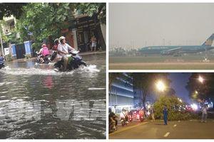 TP Hồ Chí Minh: Mưa lớn gây ngập đường, đổ cây, nhiều chuyến bay không thể hạ cánh