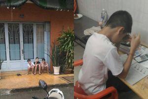 Anh em sống chết có nhau: 3 cậu bé đội mưa đợi bạn học bài xong để chơi cùng