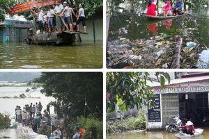 Hà Nội: Nước lũ rút dần, người dân ngoại thành vẫn phải đi lại bằng thuyền