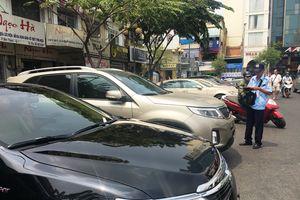TP.HCM bắt đầu thu phí ô tô dưới lòng đường