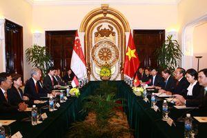 Phó Thủ tướng Trương Hòa Bình hội đàm với Phó Thủ tướng Singapore Tiêu Chí Hiền