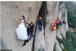 Cặp đôi đu người chụp ảnh cưới trên vách núi 100 m