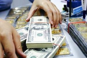 Giá vàng liên tục giảm sâu, USD tăng mạnh