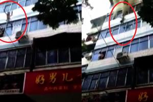 Chung cư bị cháy, người mẹ tuyệt vọng ném hai con từ tầng 4 xuống đất