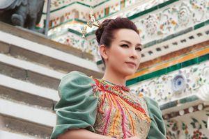 Phi Nhung mặc áo dài của nhà thiết kế Việt chụp ảnh tại ngôi chùa lớn nhất là biểu tượng của Thái Lan