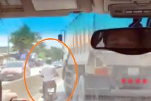 Xe tải tạt ngang đầu 'dằn mặt' xe máy