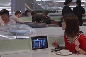 Bên trong nhà hàng tự động, robot phục vụ của Alibaba