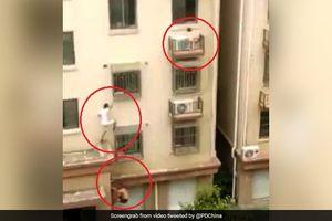 Hai 'người nhện' giải cứu bé gái mắc kẹt ngoài cửa sổ tầng 4