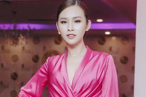 Á hậu Thanh Trang hồng rực với thiết kế của Lê Thanh Hòa