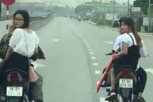 Bị triệu tập, 2 thanh niên khai nhận lý do chạy xe máy hàng ngang 'đánh võng' trên QL1A