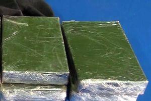 Bắt quả tang vận chuyển 4 bánh heroin tại Sơn La