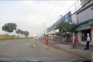 Trộm kéo lê cô gái trên đường