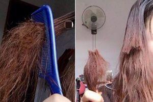 Lâu không gội đầu khiến tóc khô bết, cô gái trẻ ngậm ngùi cắt phăng chỗ tóc rồi