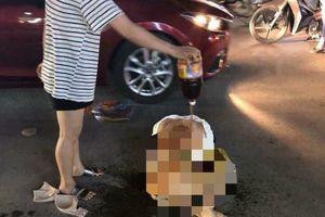 Công an điều tra vụ cô gái bị lột đồ, đổ ớt bột lên người giữa phố