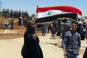 Hàng trăm tay súng nổi dậy bắt đầu rời khởi thành phố Deraa (Syria)