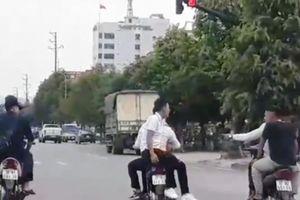 Nhóm thanh niên 'đầu trần' dàn hàng ngang trên đại lộ Lê Nin