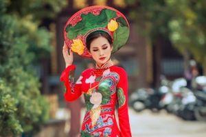 Á hậu Thanh Trang khoe đường cong 'vạn người mê' với áo dài thêu long kết phụng cầu kỳ