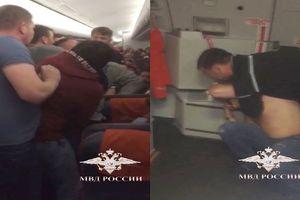 Dọa cho nổ tung máy bay, hành khách bị tóm cổ, tống giam