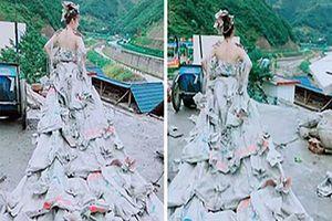 Cô gái mặc váy cưới làm từ 40 vỏ bao xi măng khiến cư dân mạng thích thú