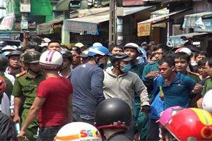 Kẻ nghi cướp giật cố thủ nhiều giờ trong tiệm game ở Sài Gòn