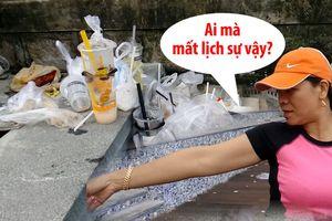 Người dân Huế tức giận vì đường lát gỗ lim ven sông Hương ngập rác