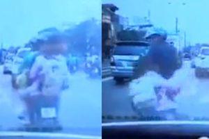 Clip cô gái nhảy xuống xe GrabBike kẹp 3 vì thấy CSGT, té trước đầu ô tô