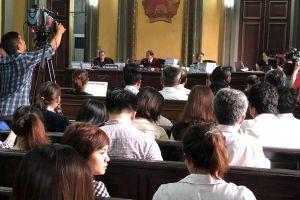 Thấy gì từ việc ngừng phiên tòa xử vụ Vinasun kiện Grab?