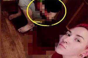 Người phụ nữ gây sốc khi đâm chồng cũ chảy máu rồi selfie