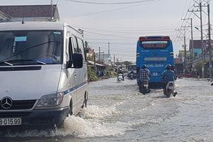 Triều cường dâng cao, nhiều đoạn Quốc lộ 1 miền Tây bị ngập