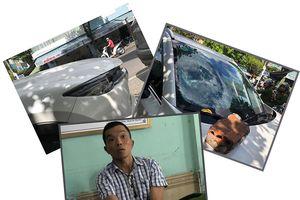 Bắt người đàn ông nghi ngáo đá đập phá ô tô