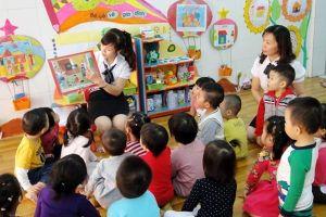 Bao giờ thực hiện miễn học phí cho trẻ mầm non lớp 5 tuổi và trung học cơ sở?
