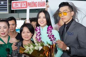 Hoa hậu Trái đất 2018 Phương Khánh giản dị với áo dài xuất hiện tại sân bay Tân Sơn Nhất
