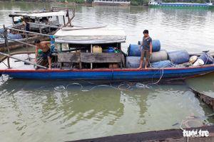 Trục vớt hết 26 tấn axit bị chìm dưới sông Đồng Nai